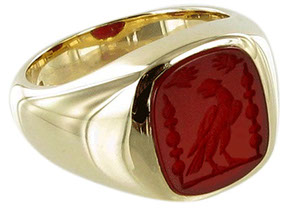 Example of a cushion shaped cornelian ring, seal engraved with a family crest.
