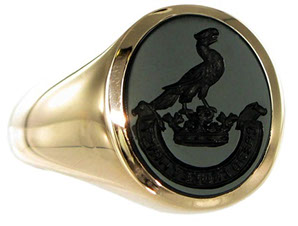 Example of a jet black Onyx signet ring. Seal engraved with a crest and motto.